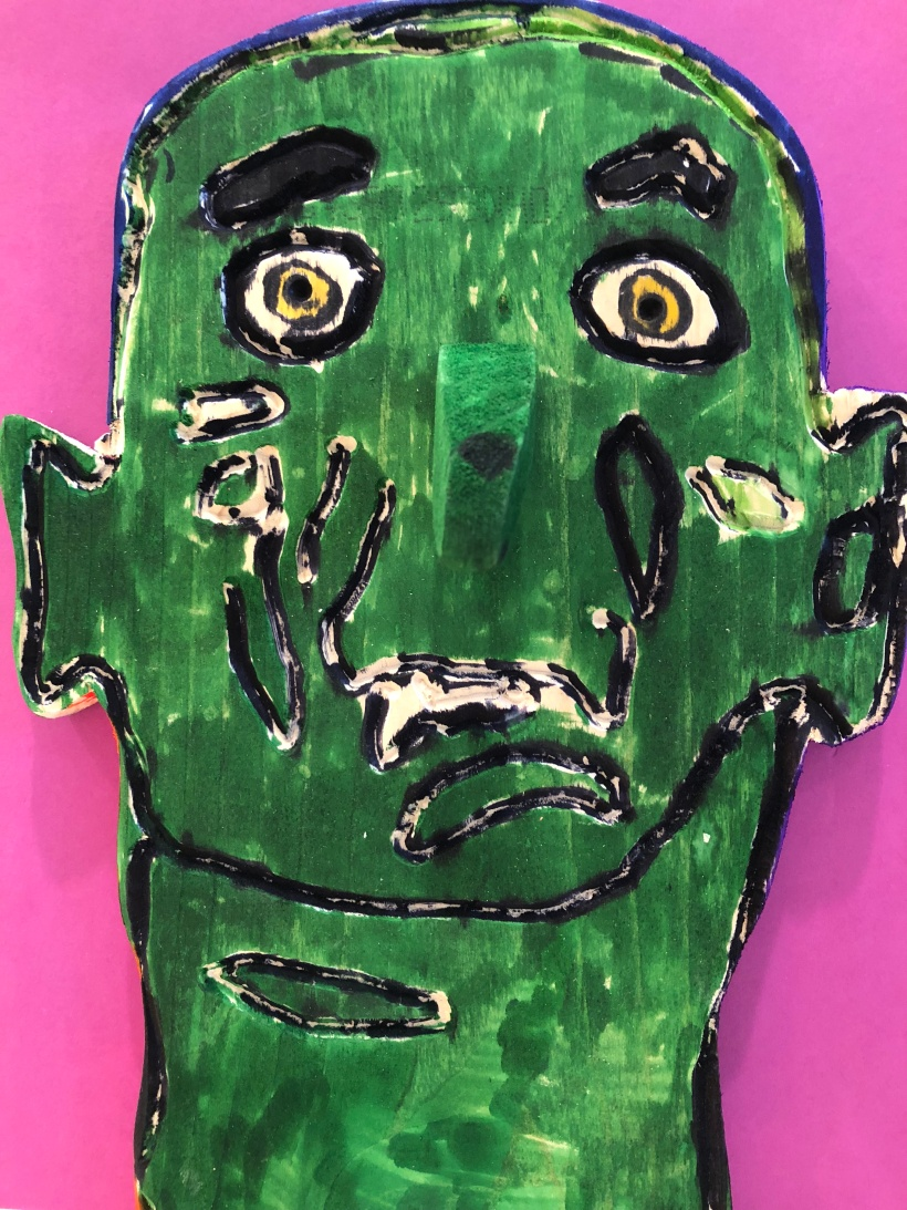 green face of a man poem
